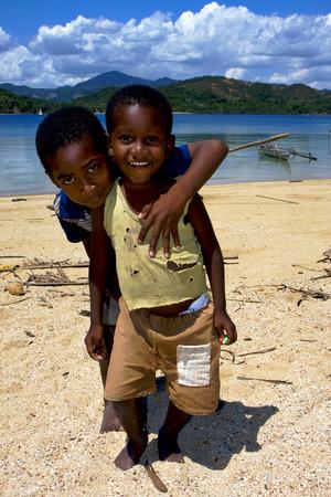 bambino: two little boys in a beach in madagascar