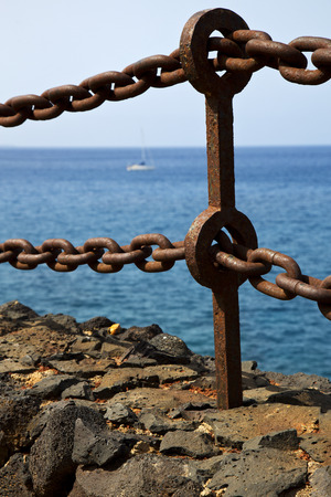 stell: rusty chain  water  boat yacht coastline and summer in lanzarote spain