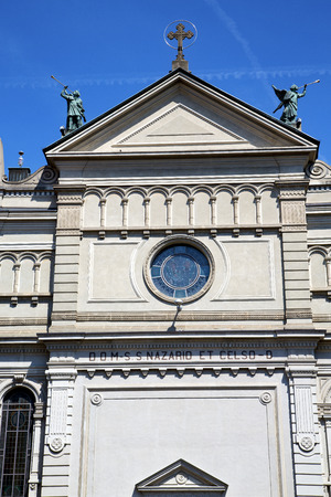 dorian: varese  castronno  in italy    the old wall  church and column blue sky Stock Photo