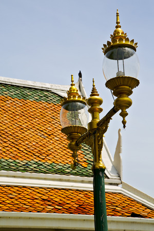 krung: bangkok in the temple  thailand abstract cross colors roof wat     asia sky   and  colors religion mosaic Stock Photo