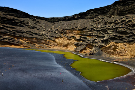 golfo: musk pond rock stone sky  water  coastline and summer in il golfo lanzarote spain