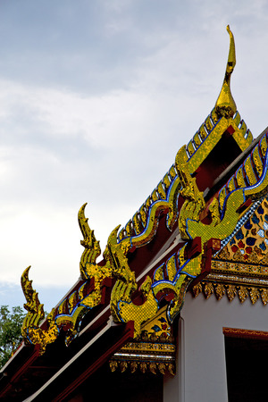 krung: thailand asia   in  bangkok rain  temple abstract cross colors  roof wat  palaces     sky      and  colors religion      mosaic Stock Photo