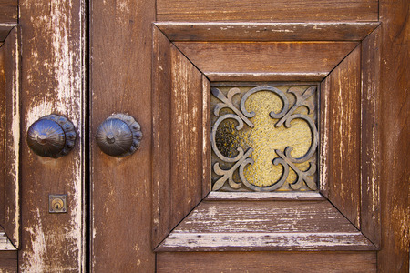 brass brown knocker and wood  glass door caronno varesino varese italy photo