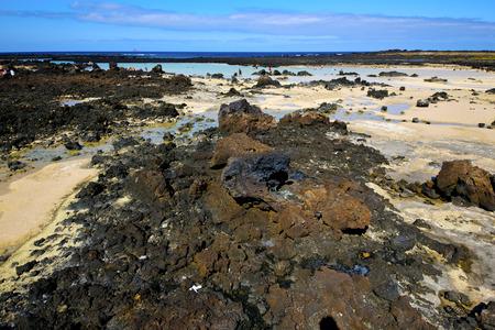 footstep: people footstep coaststone  volcanic spain  water in lanzarote  sky cloud beach  and summer Stock Photo