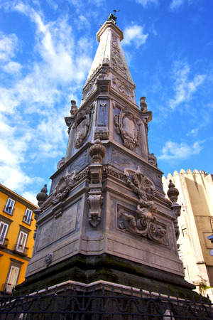 residencial: marble statue of obelisk immacolata  in the center of naples italy church