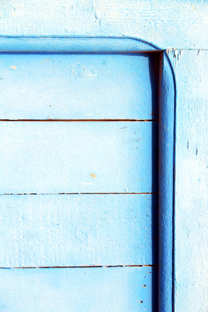 nail stripped paint in the blue wood door and rusty photo