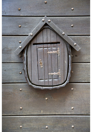 post mail: post mail abstract   rusty brass brown knocker in a  door curch  closed wood lombardy italy  varese azzate Stock Photo