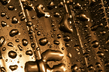 plastic material: abstract gold drop in a plastic material