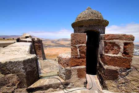 sentry: arrecife  lanzarote  spain the old wall castle  sentry tower and door  in teguise Editorial