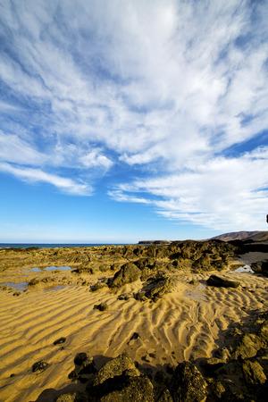 footstep: footstep in lanzarote   spain  rock stone sky cloud beach   coastline water  musk pond  and summer Stock Photo