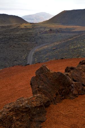 timanfaya: street in los volcanes lanzarote  spain volcanic timanfaya  rock stone sky  hill and summer