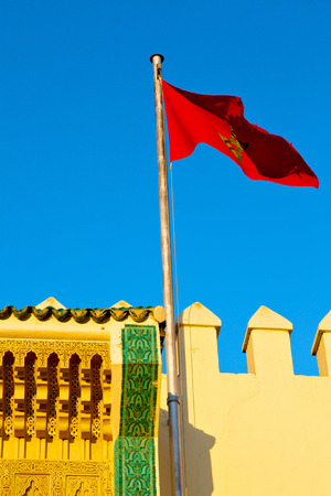 battlements: waving flag in the blue sky tunisia  colour and wave battlements