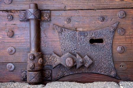 old window: castle lock spain knocker lanzarote abstract door wood in the red brown Stock Photo