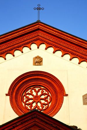 rose window: italy  lombardy     in  the barza     old   church   closed brick tower   wall rose   window tile  shutter Stock Photo