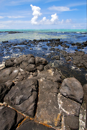 cocos: foam footstep indian ocean some stone in the island of deus cocos in mauritius