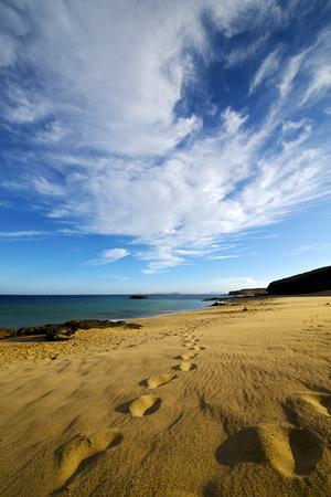 footstep: footstep in lanzarote   spain  rock stone sky cloud beach  water  musk pond  coastline and summer Stock Photo