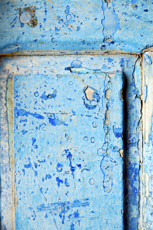 stripped: nail stripped paint in the blue wood door and rusty Stock Photo