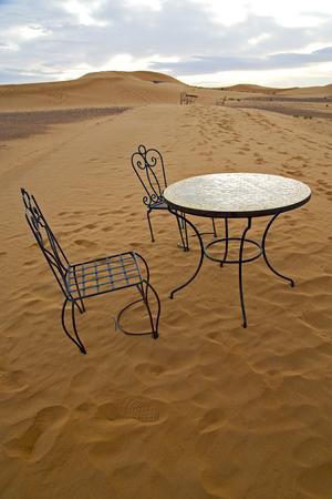 sahara desert: table and seat in  desert sahara morocco    africa yellow sand
