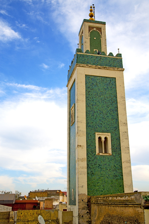 casbah: mosque muslim     the history  symbol  in morocco  africa  minaret   religion and  blue    sky Stock Photo