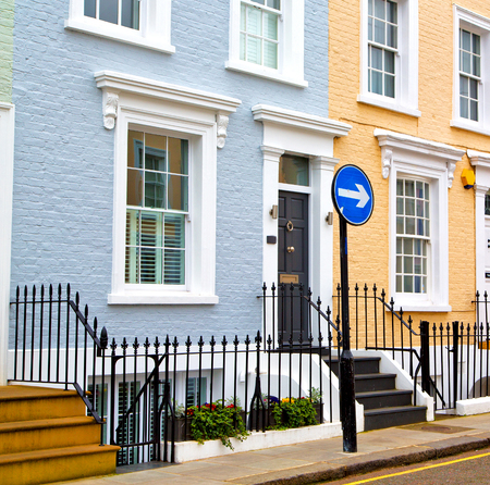 front angle: notting hill in london england old suburban and antique      wall door Stock Photo