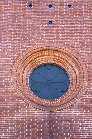 rose window: italy  lombardy     in  the  sumirago  old   church   closed brick tower   wall rose   window tile