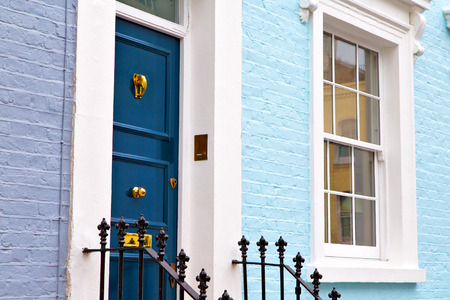 notting hill in london england old suburban and antique    wall door 写真素材