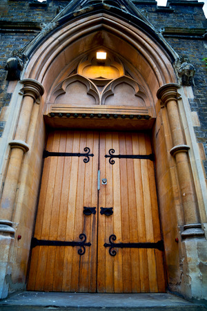 old church: wooden parliament in london old church door and marble antique  wall Stock Photo