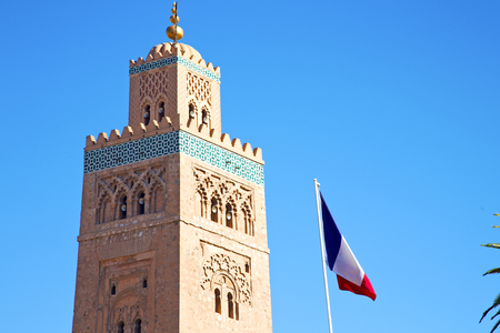 old flag: in maroc africa      minaret  and the blue     sky Stock Photo