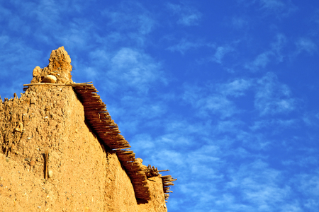 casbah: africa  in histoycal maroc  old construction  and the blue cloudy  sky