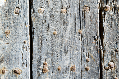 stripped paint in the blue  wood door      and rusty      nail