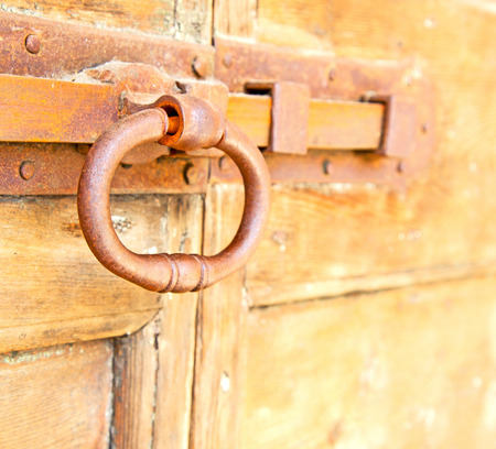 europe closeup: europe old in  italy  antique close brown door and rusty lock  closeup