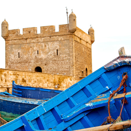 boat and sea in africa morocco old castle brown brick  sky Banque d'images