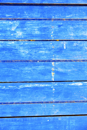 rusty nail: nail stripped paint in the blue wood door and rusty Stock Photo
