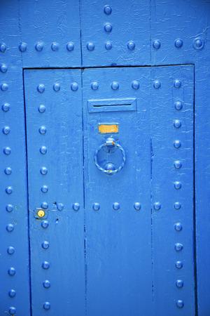antique door in morocco africa blue wood and metal rusty