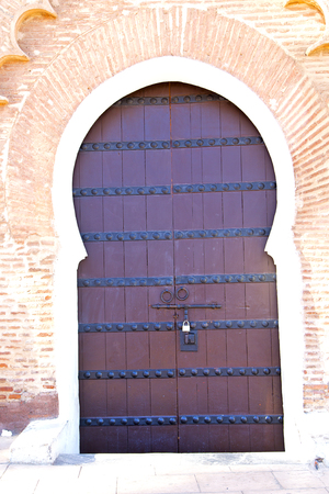 knocker: historical in  antique building door morocco style africa   wood and metal rusty Stock Photo