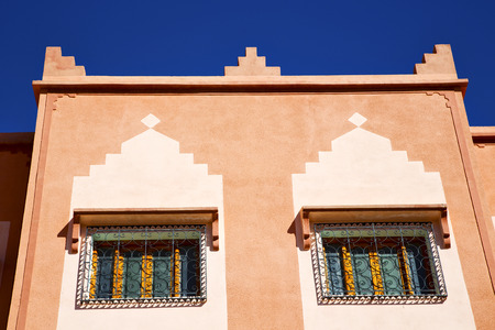 security shutters: window in morocco africa and old construction wal brick historical Stock Photo