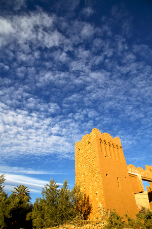 maroc: africa  in histoycal maroc  old construction  and the blue cloudy  sky