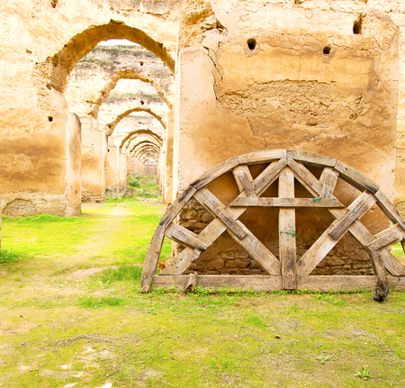 granary: old moroccan granary in the green grass and archway  wall Editorial