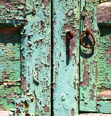 canarias: abstract  spain canarias brass brown knocker in a green closed wood  door  lanzarote