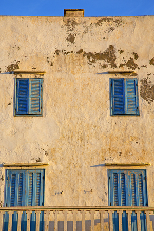 metal grate: window in morocco africa and old construction wal brick historical Editorial