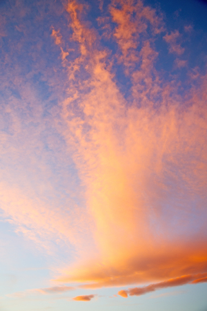sunrise in the colored sky white soft clouds and abstract background Stock Photo