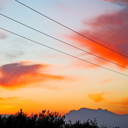 power cables: mountain in morocco africa and red sunrise current cables   power pylon