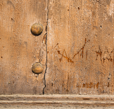 door lock love: abstract   rusty brass brown knocker in a  door curch  closed wood lombardy italy  varese lonate pozzolo