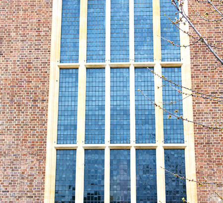glass brick: old windon in england london brick and glass the wall Stock Photo