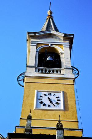 sunny day: cislago    old abstract in  italy   the   wall  and church tower bell sunny day