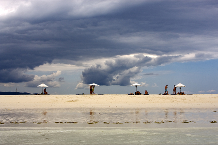 nosy: parasol people  hill lagoon and coastline in madagascar nosy be Stock Photo