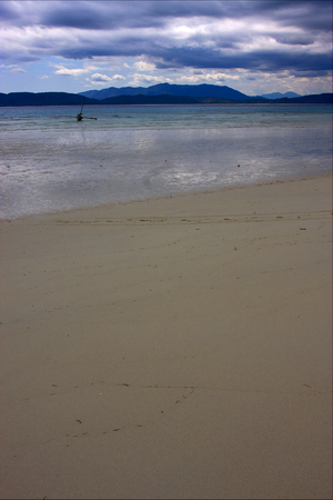 footstep: footstep  boat palm  rock stone branch hill lagoon and coastline in madagascar nosy be