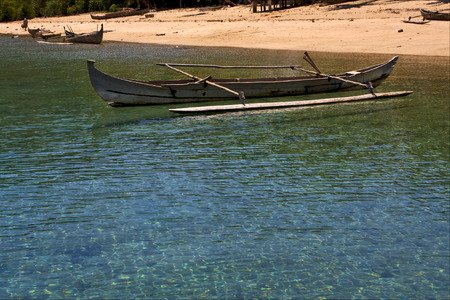 nosy: boat sand lagoon  water reflex and coastline in madagascar nosy be