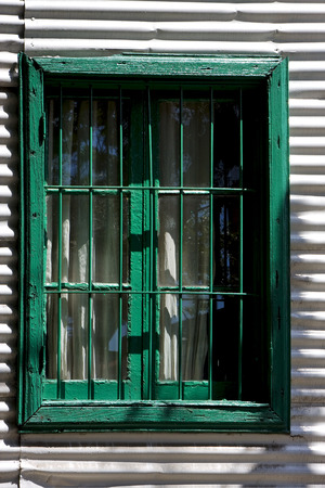la boca: green wood venetian blind and a metal wall in la boca buenos aires argentina Stock Photo