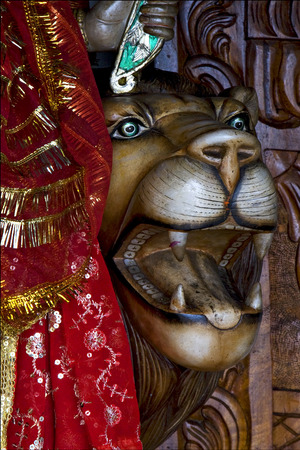 precious stone: head of lion precious stone marble  wood statue of a Hinduism  women  Shiva vishnu Brahma in a temple near a lake in mauritius africa